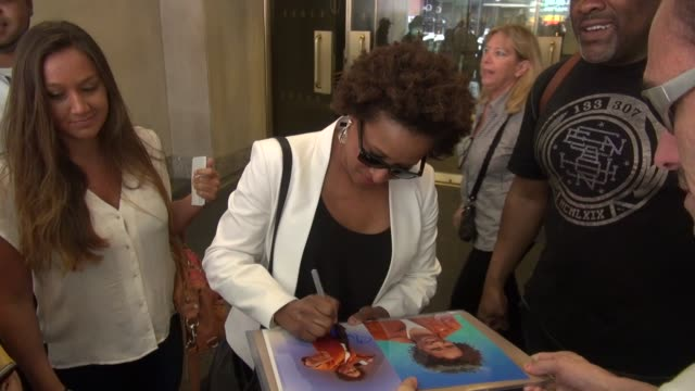 wanda sykes exits the today show in rockefeller center signs for poses wih fans before leaving in celebrity sightings in new york - wanda sykes stock videos and b-roll footage