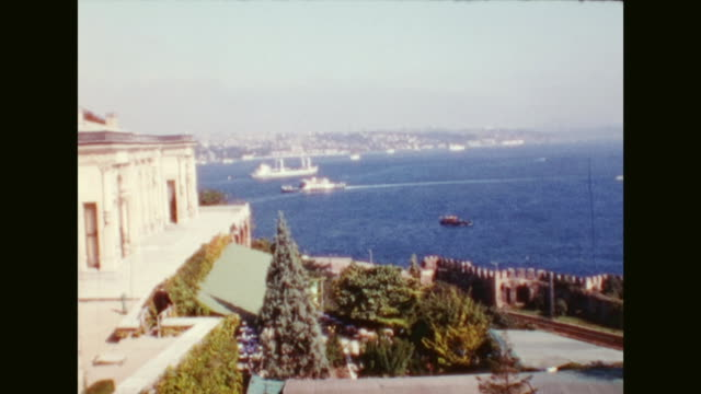 wandering through topkapi palace views of city from the palace gardens including the galata tower and the bosphorus driving by bus over the bosporus... - july 15 martyrs' bridge stock videos & royalty-free footage