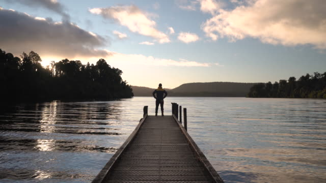wanderlust at lake mapurkia. - new zealand culture stock videos & royalty-free footage