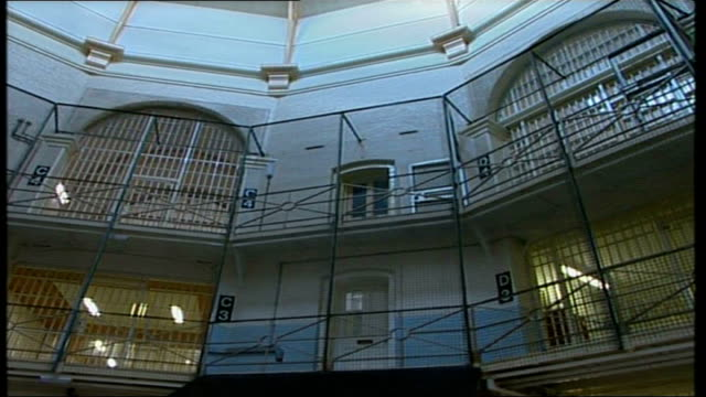 stockvideo's en b-roll-footage met exteriors and interiors bbc england london wandsworth prison ext wandsworth prison buildings / security cameras on building / people along enter... - wandsworth