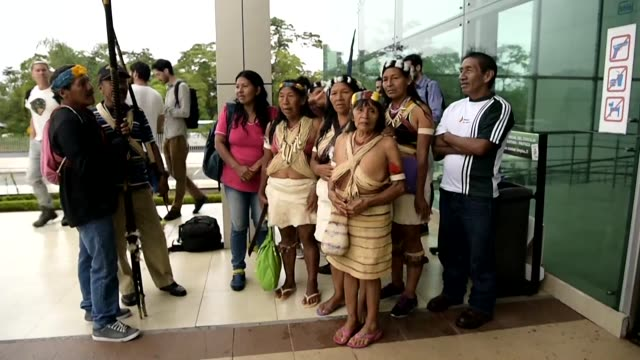 waorani indigenous people go to the courthouse in puyo ecuador where a legal bid to halt the government's plans to open up their lands to oil... - ecuador stock videos & royalty-free footage