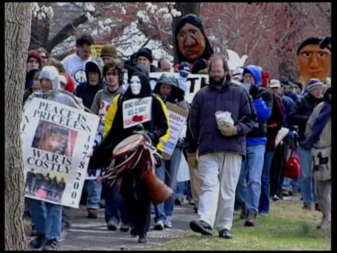 3rd anniversary of beginning of war washington dc ext antiiraq war demonstrators marching away as carrying coffin with financial and social... - {{relatedsearchurl(carousel.phrase)}} stock videos & royalty-free footage