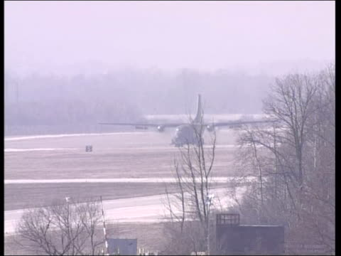 handover of ratko mladic demanded; bosnia: tuzla: ext general view airplane taxing on runway of nato airbase in mist - ratko mladic stock videos & royalty-free footage