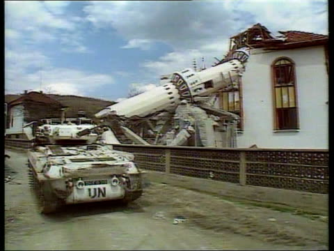 bosnian croats jailed lib herzegovina ahmici ext armoured vehicles of british un forces along track track british soldiers riding in armoured vehicle... - bosnia and hercegovina stock videos & royalty-free footage