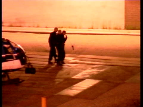 slobodan milosevic lawyer's prepare defence; itn netherlands: the hague ext / night tgv police helicopter on ground to former yugoslav president... - slobodan milosevic stock-videos und b-roll-filmmaterial