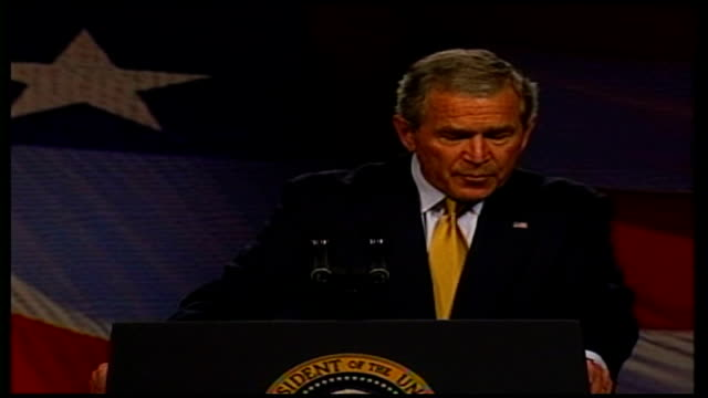 stockvideo's en b-roll-footage met int long shot of george w bush standing at podium during speech to large audience george w bush speech sot terrorists know that the outcome in the... - george w. bush