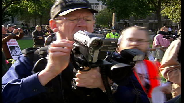 Parliament Square peace protestors Vars police cameraman videos protestors as talking with police officers/ protestors read out names of Fallujah...