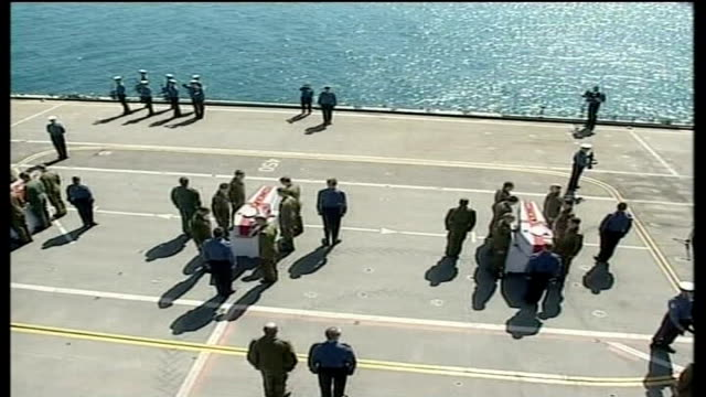 sea king helicopter deaths inquest lib persian gulf hms ark royal repatriation service on deck of ark royal for 3 of 6 men killed in sea king... - 船の一部点の映像素材/bロール