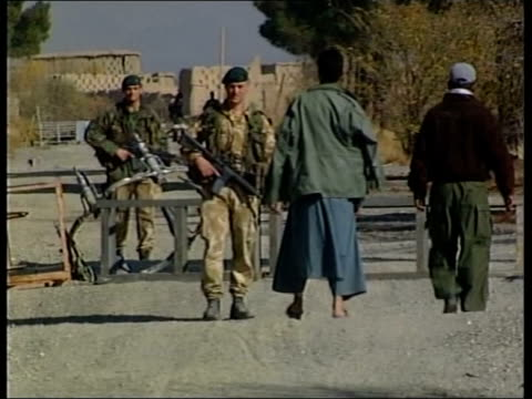 Hunt for Osama Bin Laden narrows LIB LMSs British special forces soldiers speaking to Afghans at entrance to airbase