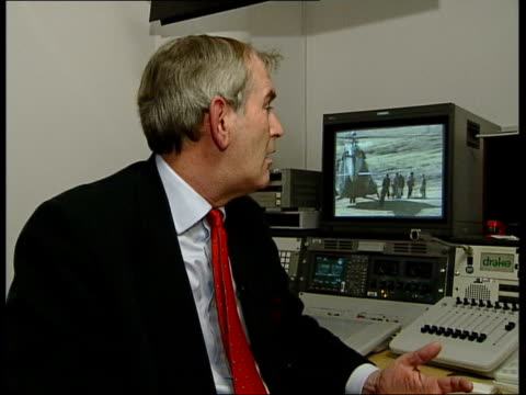 send in special forces/northern alliance preparations; itn england: london: gir: int charles heyman interview sot - look like members of western us... - mi6 stock-videos und b-roll-filmmaterial