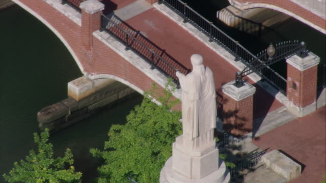 AERIAL WWI War Memorial at Garner-Jackson Park next to pedestrian and vehicle bridges crossing Providence River canal in downtown / Providence, Rhode Island, United States
