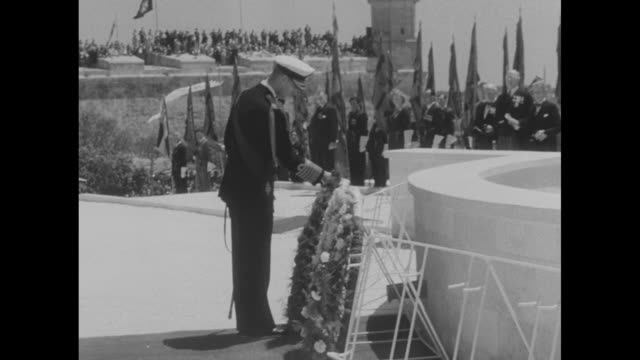 ls of war memorial base decked with banners and bunting / cu of plaque on memorial / ls elizabeth ii lays wreath at base of memorial / ls prince... - memorial plaque stock videos and b-roll footage