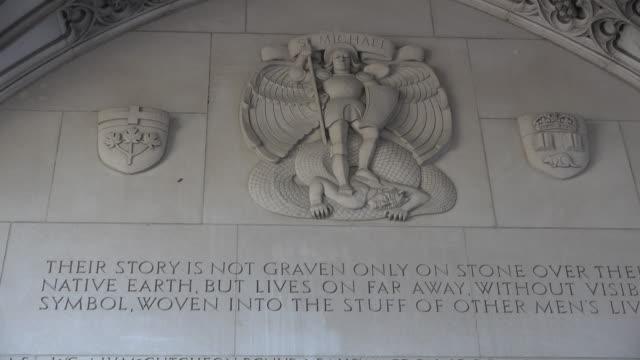 war memorial in the university grounds: saint michael wall - 天使ミカエル点の映像素材/bロール