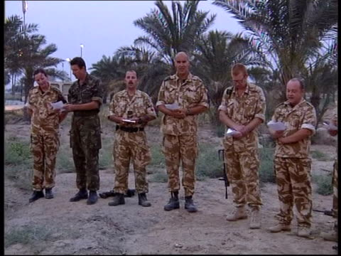 War on Iraq ITN IRAQ Basra BV Desert Rats soldiers taking part in Easter religious service in the grounds of one of Saddam's palaces