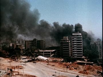 vídeos y material grabado en eventos de stock de war planes bombing beirut, smoking, burning buildings / soviet propaganda film about the 1982 lebanon war. - vehículo aéreo