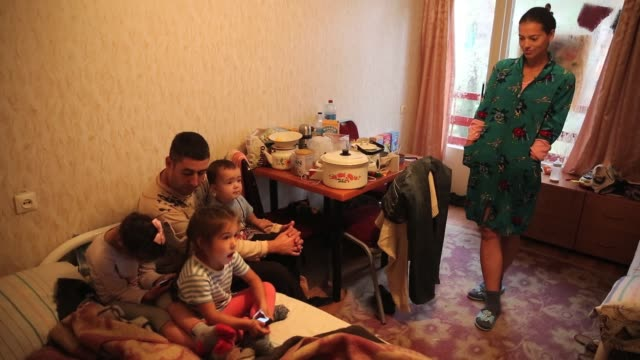 war refugees live in a one room apartment away from the front line in the slavyansk area where the prorussians and ukrainian military fought a major... - ukraine stock-videos und b-roll-filmmaterial