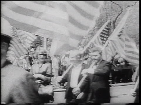 war veterans carrying american flags on pro-vietnam war parade / nyc / newsreel - war veteran stock videos & royalty-free footage