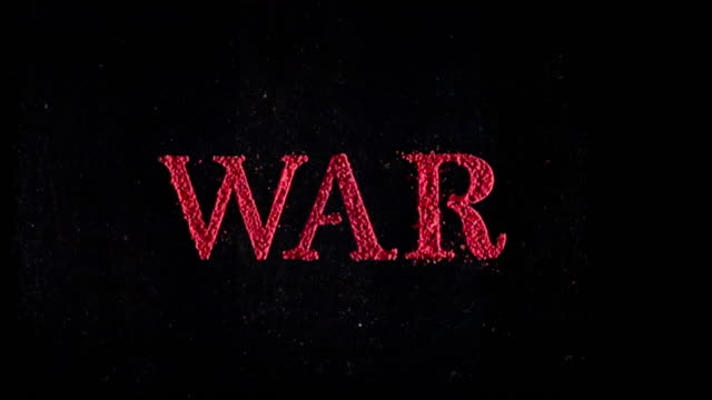 War written in red powder exploding in slow motion.
