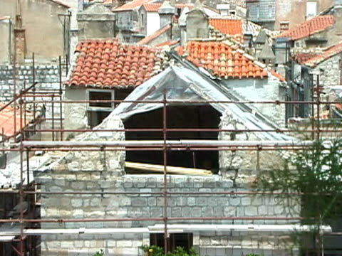 War Zone: Roof Damage, with Tarpaulins and Scaffolding