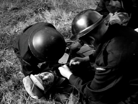 wardens treat injured people during a civil defence exercise in east anglia. - east anglia stock videos & royalty-free footage