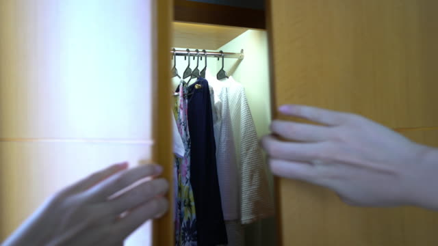 wardrobe and shirt selection - wardrobe stock videos & royalty-free footage
