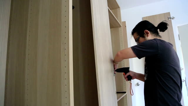 wardrobe - cabinet stock videos and b-roll footage