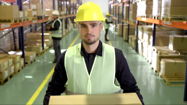 Warehouse Employee Handing Over A Package