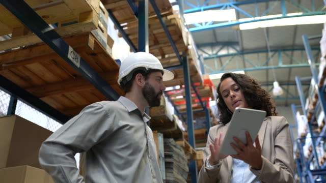 warehouse employees discussing delivery schedules - paperwork stock videos & royalty-free footage