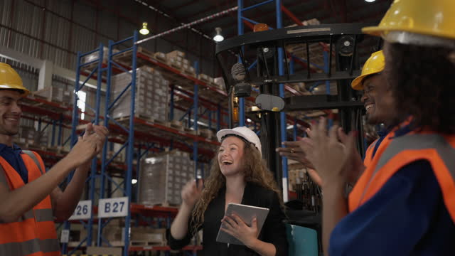 warehouse employees working at logistics center. - employee stock videos & royalty-free footage