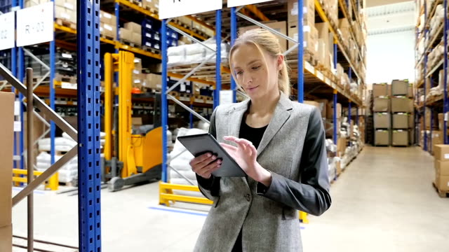 warehouse female manager using tablet - forklift truck stock videos and b-roll footage