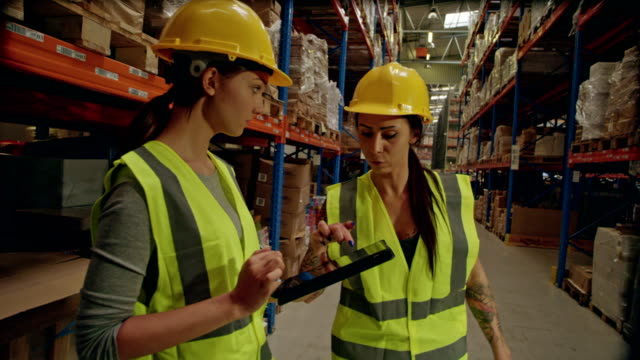 Warehouse female workers checking inventory
