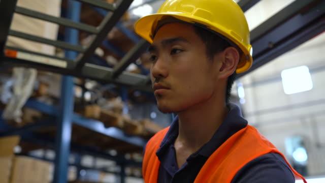 warehouse forklift operator - work helmet stock videos & royalty-free footage