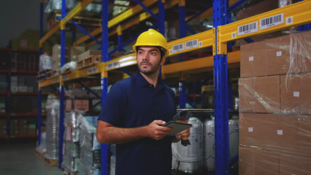warehouse man worker use bar-code scanner scan and checking product stock - mitarbeiterengagement stock-videos und b-roll-filmmaterial