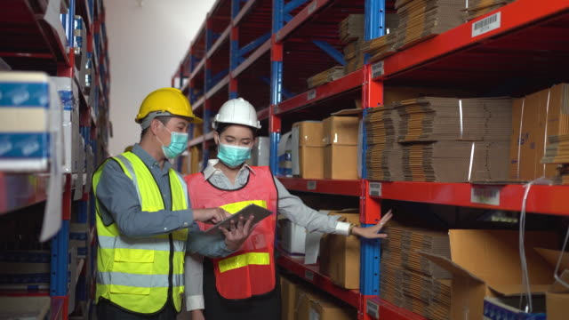 warehouse officers check the product at warehouse - rack stock videos & royalty-free footage