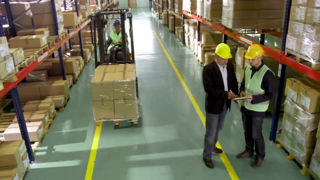warehouse staff meeting - warehouse stock videos and b-roll footage