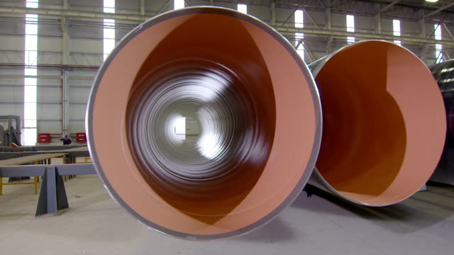 warehouse with big diameter pipes stacked on the floor. - building storey stock videos and b-roll footage