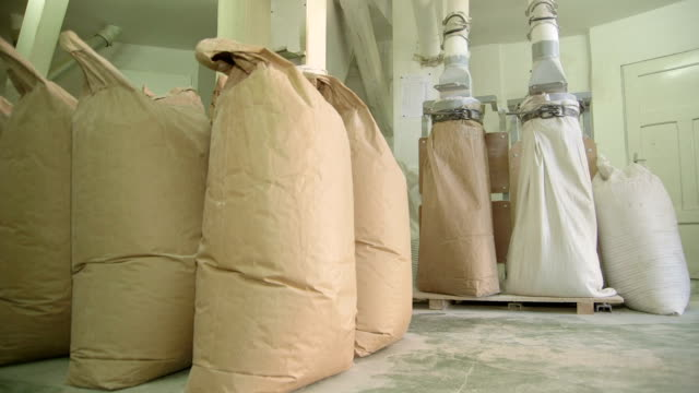 warehouse with sacks of flour - bag stock videos & royalty-free footage