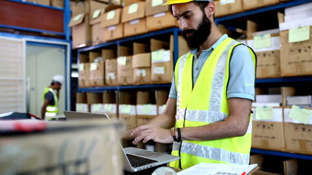 warehouse worker checking stock products - receiving stock videos & royalty-free footage