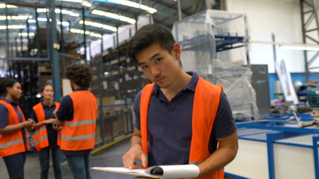 warehouse worker looking at the checklist - employee stock videos & royalty-free footage