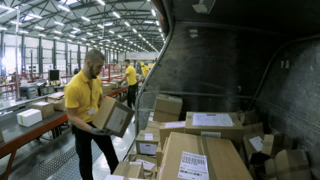 ld warehouse worker placing packages on the conveyor belt - unloading stock videos & royalty-free footage