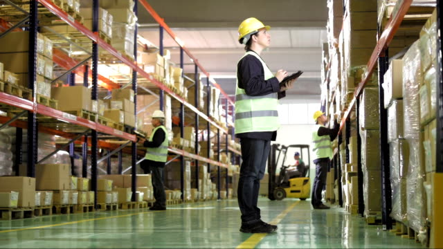 warehouse worker using a digital tablet - helmet stock videos & royalty-free footage