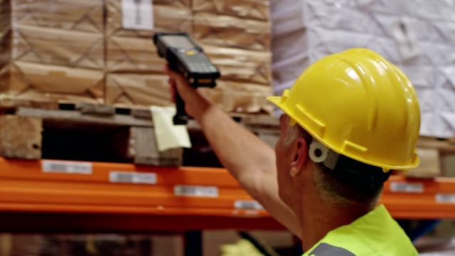 warehouse worker using bar code reader - deposito video stock e b–roll