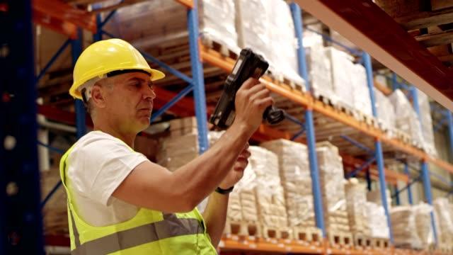 Warehouse worker using bar code reader