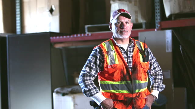 warehouse worker wearing reflective vest - 50 54 years stock videos & royalty-free footage