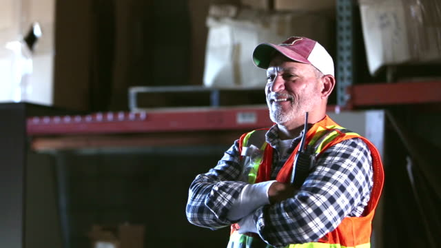 warehouse worker wearing reflective vest - trucker cap stock videos & royalty-free footage