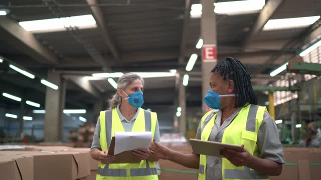 warehouse workers checking information on digital tablet while walking - maintenance engineer stock videos & royalty-free footage