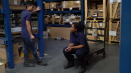 Warehouse workers talking during a work break