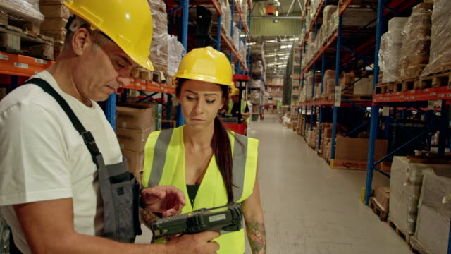 warehouse workers using bar code reader. checking the inventory - work tool stock videos & royalty-free footage