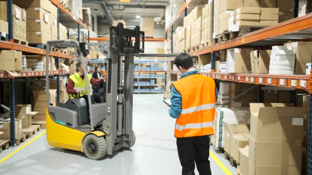warehouse workers. - forklift stock videos & royalty-free footage