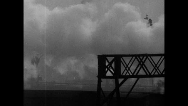 montage warehouses, railways and docks along the thames river as it winds through the city into the center of town / london, england, united kingdom - 1939 stock-videos und b-roll-filmmaterial